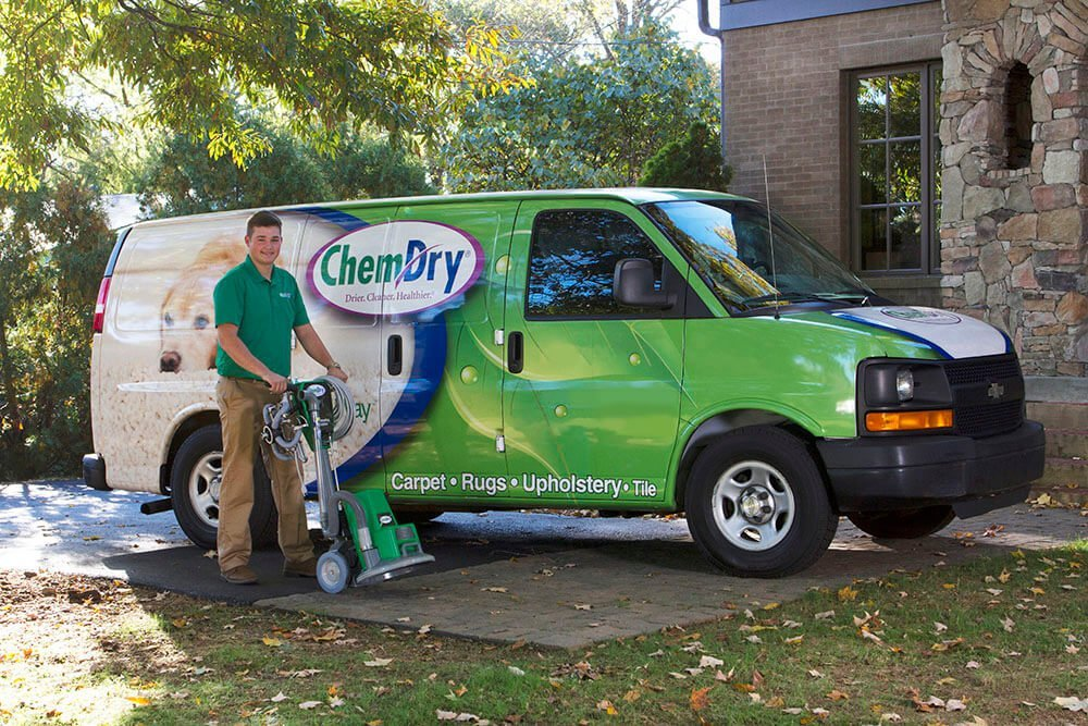 chem-dry tech standing outside of green cleaning van