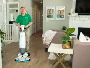 chem-dry tech performing wood floor cleaning