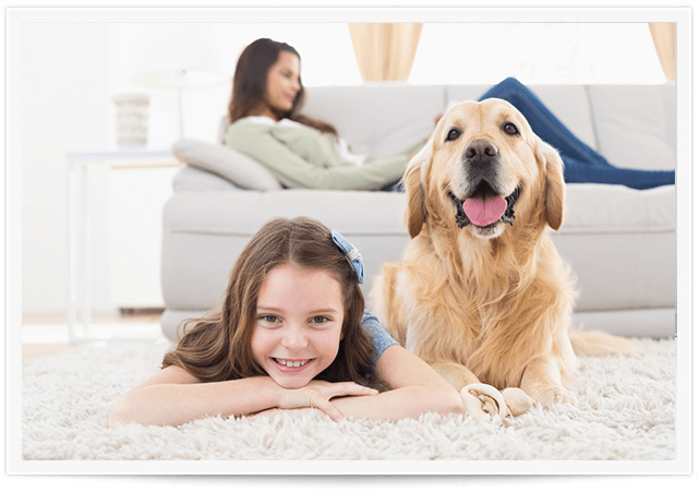 girl and dog laying on clean carpet