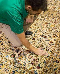 chem-dry tech inspecting rug in orange county ca