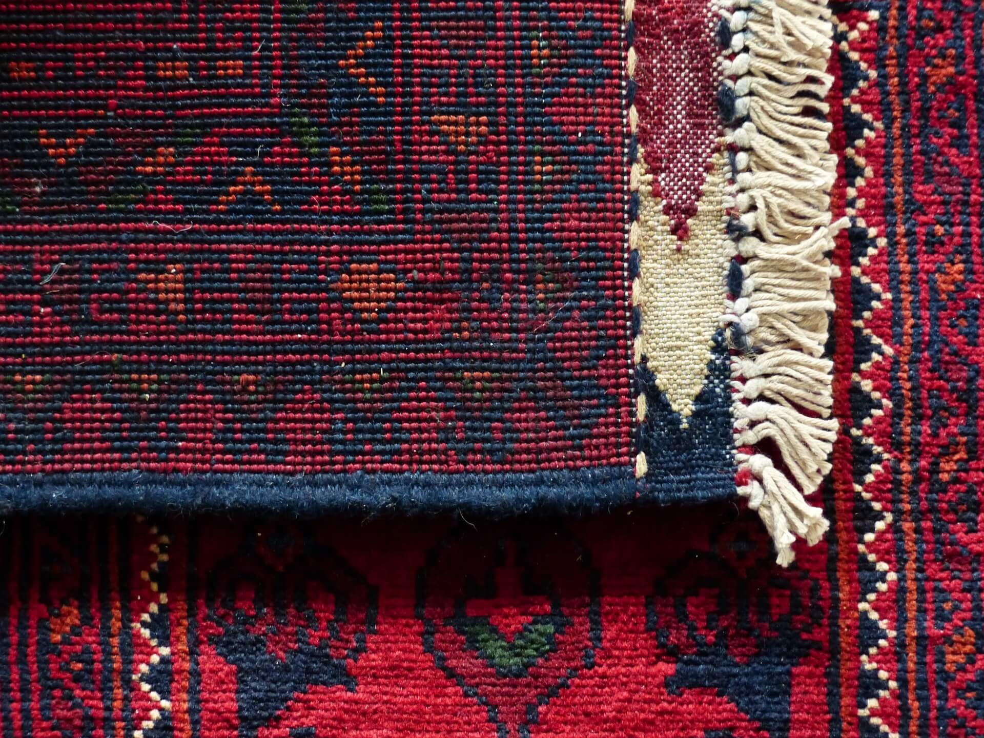 Blue and maroon colored rugs