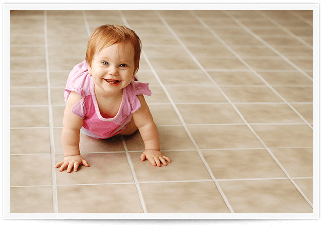 baby crawling on clean tile