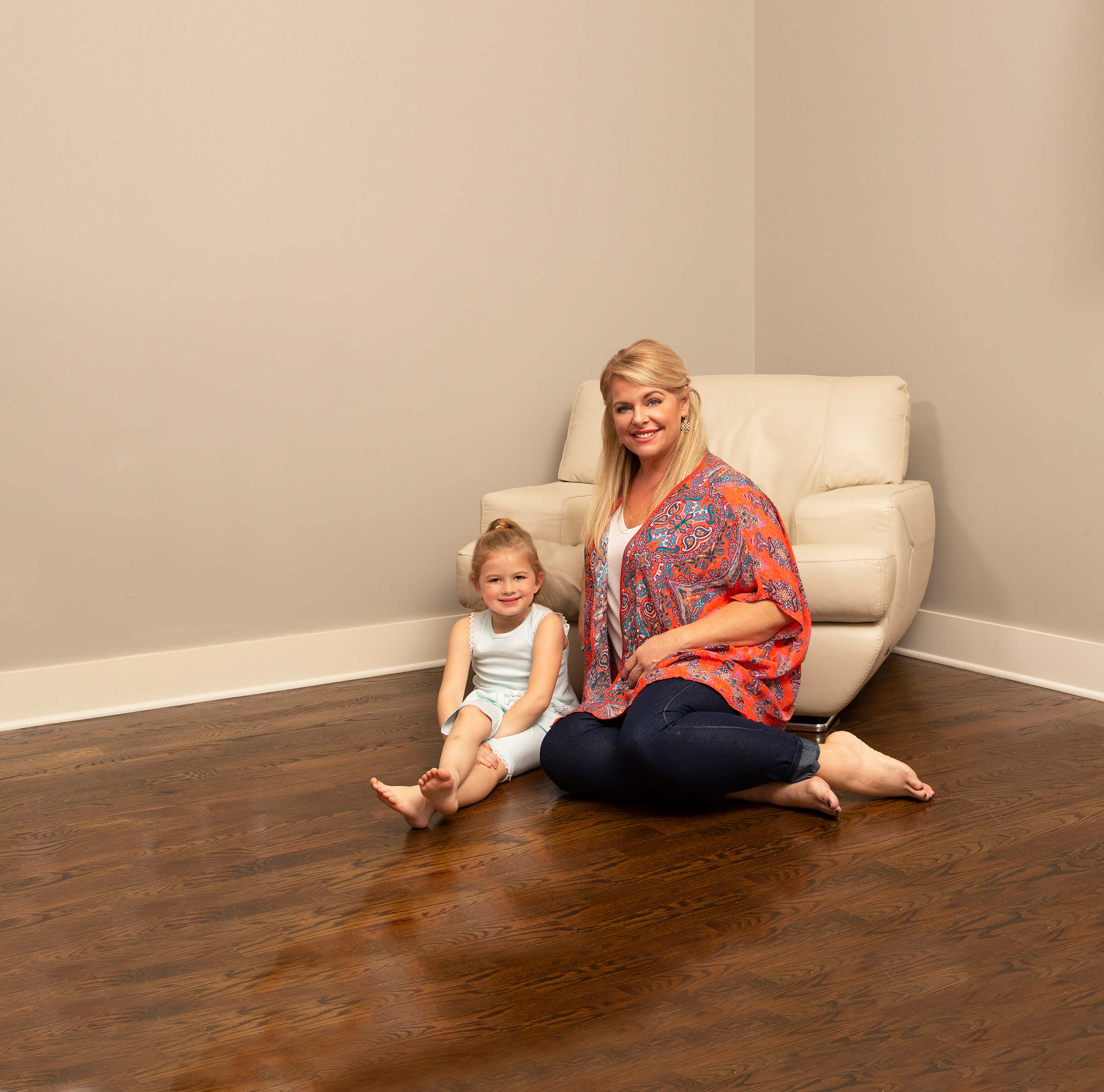 family playing on clean wood floor in orange county home