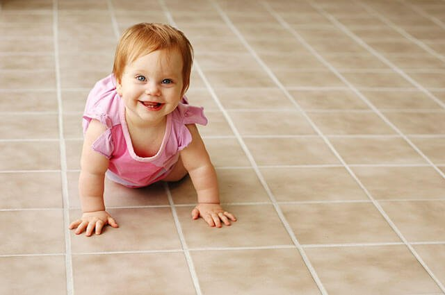baby crawling on tile