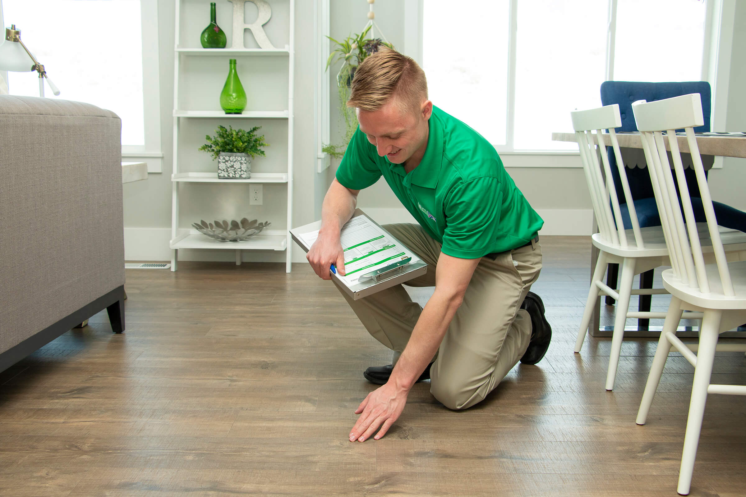 Chem-Dry tech inspecting wood floors in orange county