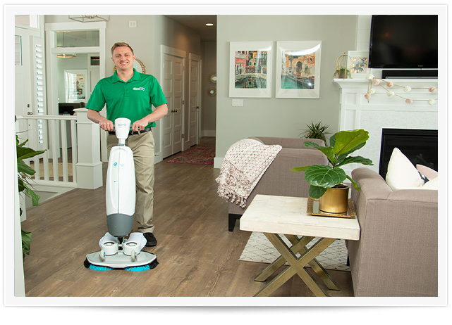 chem-dry tech performing wood floor cleaning in orange county