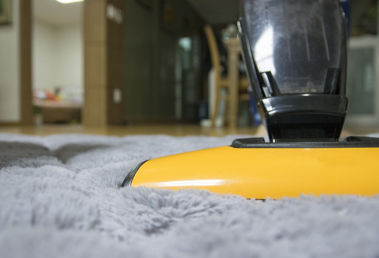 yellow vacuum cleaning gray rug